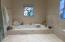Luxurious, spa-like Master Bath with sunken bathtub