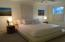 Large Master bedroom with new carpeting and walk-in closet