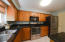 gleaming granite surfaces and stainless appliances