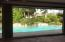 Remote for automatic screens overlooking pool area.