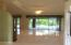 Open family room overlooking pool and screened in patio area.