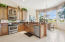 GRANITE COUNTERS AND FULL BACK SPLASH; UNDER MOUNT SINK; OVERLOOKS DINING AREA