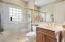 LARGE FRAMELESS SHOWER, GLASS BLOCK WINDOWS FOR LOTS OF NATURAL LIGHT AND PRIVACY