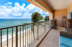 Enjoy direct ocean views from the covered balcony rain or shine.