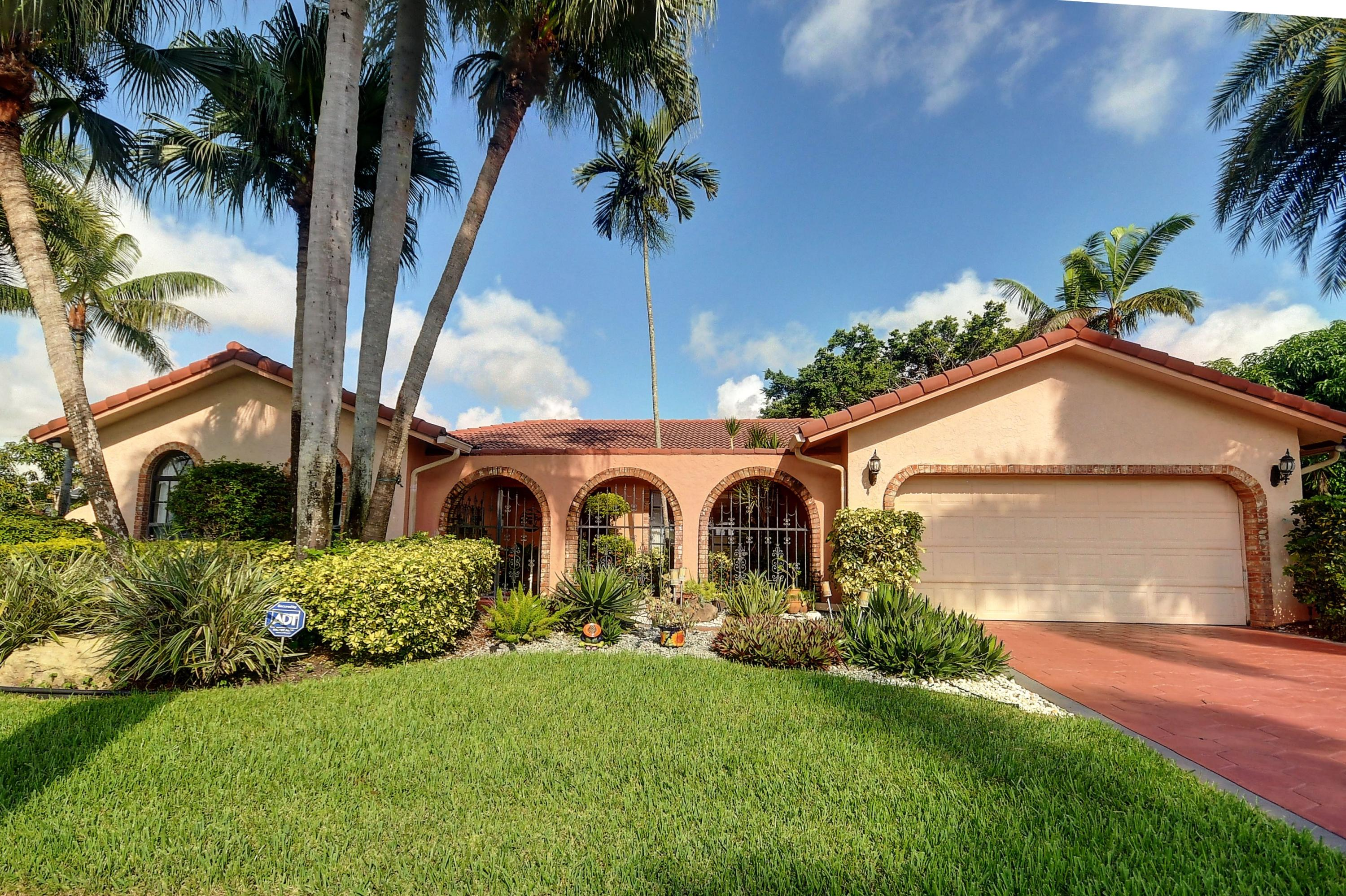 This is the house to show.  This unique home is in the estate section of Boca Greens and sits on a huge, double sized lot.  It is also one of the largest homes in the community. It has a beautiful custom kitchen with sun drenched breakfast area, huge great room, formal dining and an oversized master suite that has to be seen to be appreciated.  Walk to worship, close to shopping, huge parks. Boca Greens is a gated community of almost 600 homes located one mile north of Glades road on US 441. This community is also the home of the Boca Greens County Club. All residents can play the course on a pay for play basis. No membership is required. But for those who do want a country club experience there are a number of non-equity memberships available. Premium cable package and high speed Intern