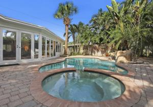 Private backyard oasis includes heated pool, jetted spa and waterfall.