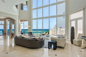 Main level living room is spanned by two-story ceilings and grand Atlantic vistas.