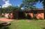 Large back yard- fire pit, covered area, garden, grass and a shed