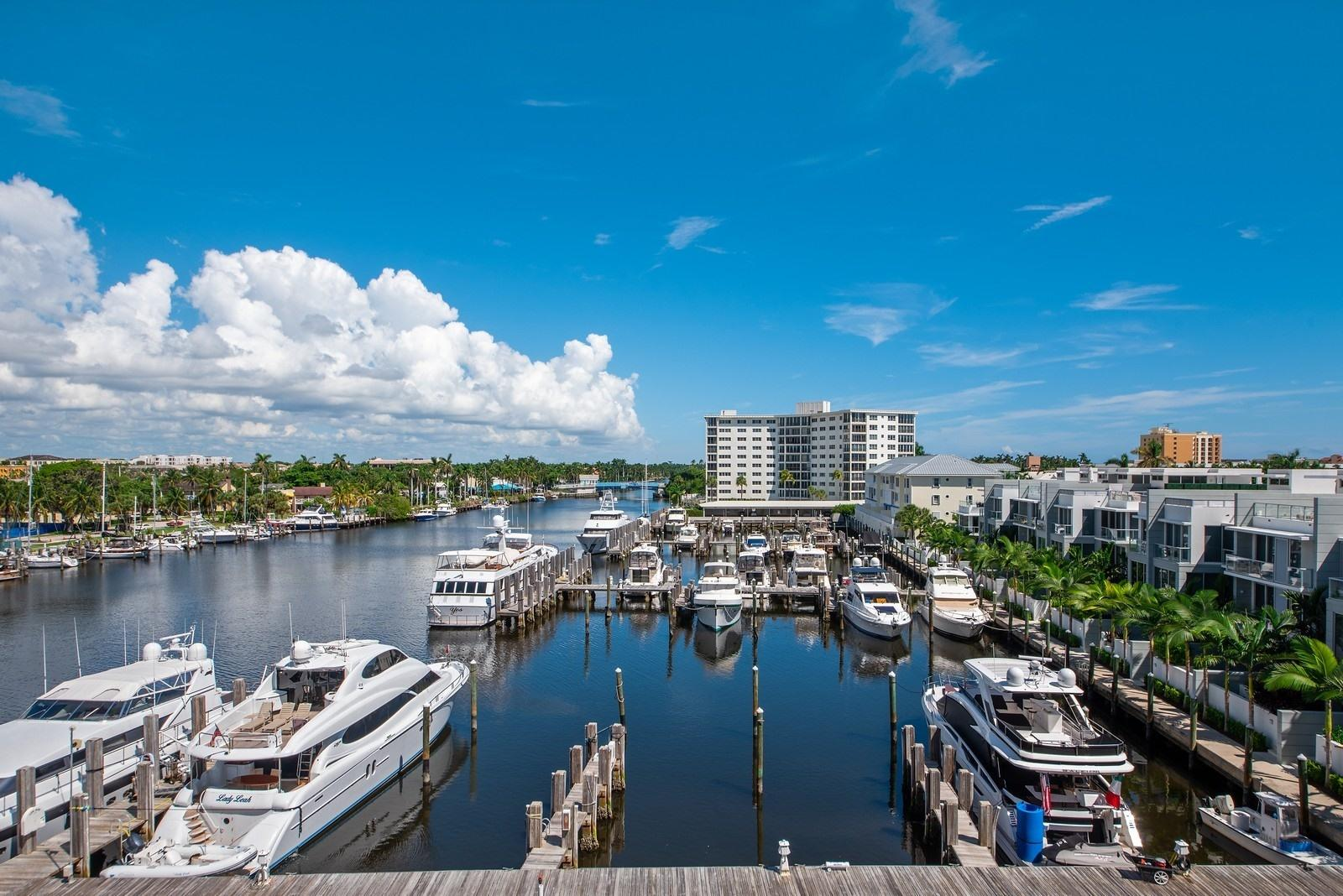 Beautiful unobstructed views of the yacht club north & the intracoastal south from this 5th floor unit that has 2 balconies. Features include, hardwood flooring throughout, renovated bathrooms, newer AC, & new washer/dryer.  Seagate Towers is situated wonderfully... just 2 blocks from Atlantic Ave & the beach. Boat dockage is available and included in the maint! Impact Glass windows, door man, exercise room & social room overlooks the large pool area along the waterway. Shows great, this unit is immaculate!