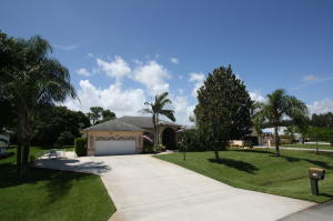 Front of home. Large/wide driveway with room for RV/Boat on left side.