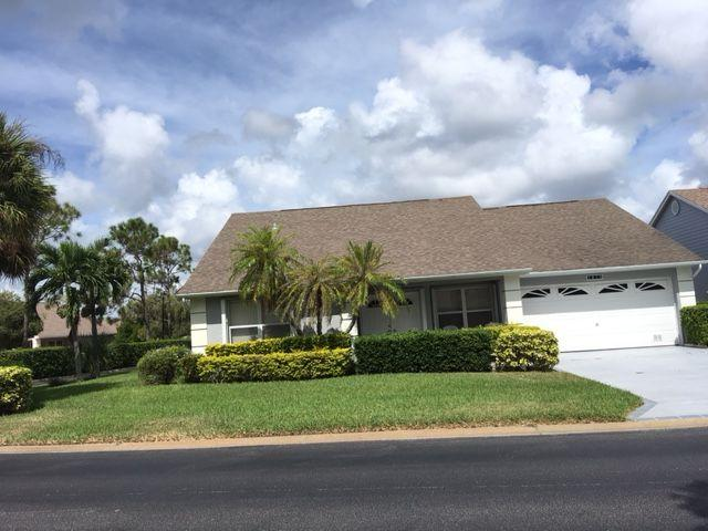 Kings Isle (55+ community). St. Lucie West. Perfect opportunity for a beautiful home under $200,000!!  Corner home (Diamond 2 model) with additional parking behind house. 2/2 with den and family room. 2 car garage.  Kitchen was upgraded 1 year ago.  All new kit.  appliances. Cabinets have new doors. Granite countertops. New tile flooring - in kitchen, family room and laundry.  Designer driveway - apprx. 1 year ago.  Accordian shutters for all openings.  Covered front porch - perfect for enjoying the evenings.  Large back screened porch - 20 x 10. No neighbors immediately behind.  Capital contribution to both Isles at closing.