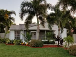 Move in ready, updated kitchen and bath, large fenced yard, screened front porch, many palm trees