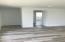 Hallway leading to split bedrooms.