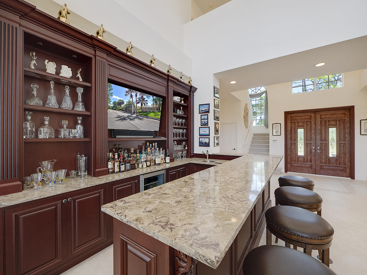 Newly installed bar (2017) featuring Quartz tops, wine/beverage fridge, ice maker and wet sink.  Large heated pool and spa with waterfall feature and a paver deck . The kitchen has center island cooktop, wine rack and double wall ovens. 1st Floor master bedroom has its own sitting room and private access to the pool. Master bath features double vanity, whirlpool tub and separate shower.  The den features beautiful built in cabinets/desk and Murphy bed for those unexpected overnight guests. One separate bedroom upstairs off the kitchen and laundry area, 2 bed/2 bath (ensuite) upstairs on the other side. Bonus rm with upper terrace access. Bridge open to the parlor/bar. 3 new A/C & new W/D 2017 ...LOW HOA $176/mo.  Call your bank and get pre-qualified and call me today before its too late!