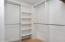Spacious Custom Closet is located off the master bathroom. An additional en-suite closet is in the master bedroom