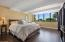 Recessed lighting tucked into the beamed ceilings create a quiet calm in the Master Bedroom