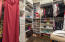 Spacious double walk-in closets.