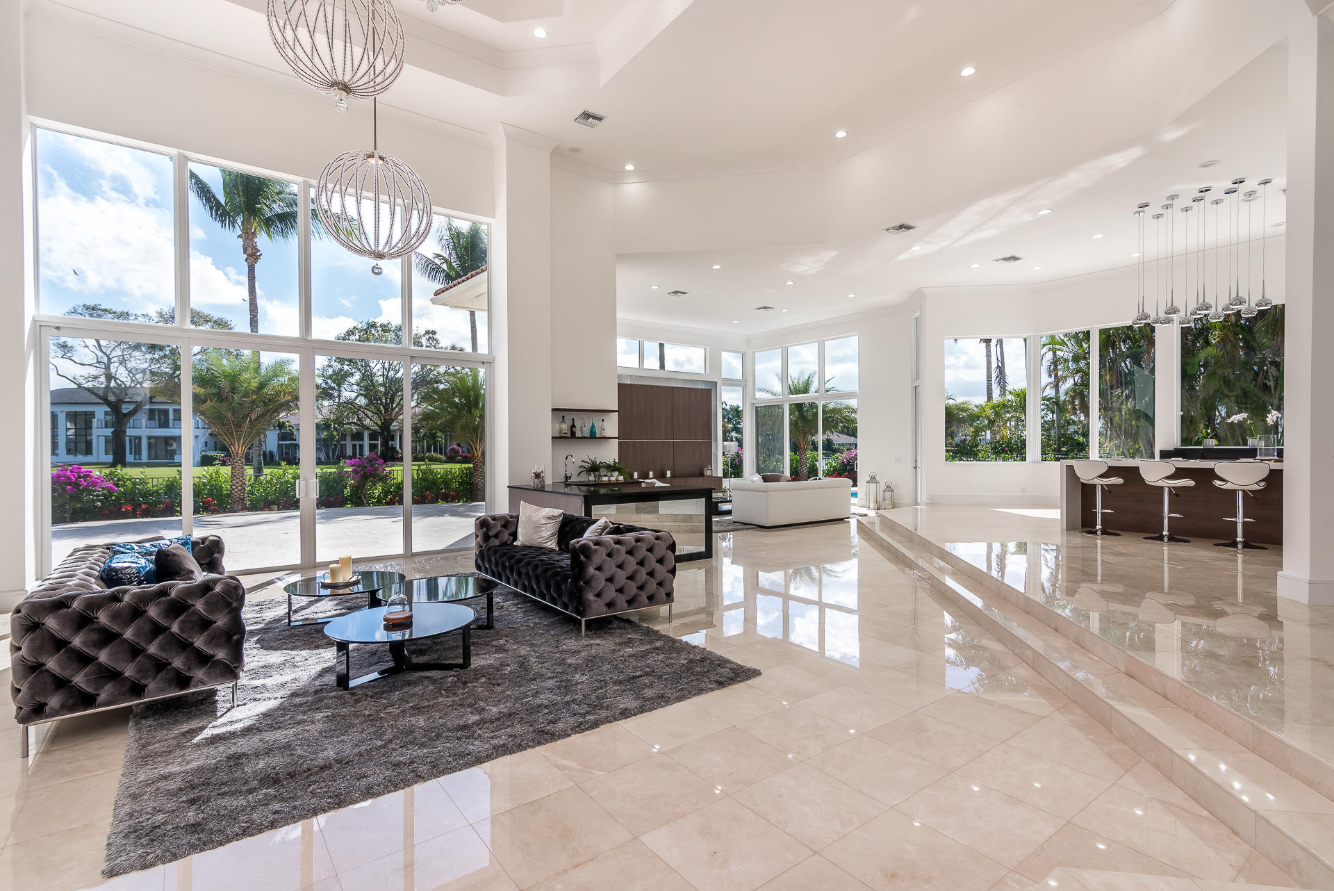 Stunning TOTALLY RENOVATED contemporary estate on an oversize lot in prestigious St Andrews Country Club with dramatic lake and golf views! Totally re-imagined in 2017 with a clean contemporary aesthetic! European finishes amaze throughout this 5-bedroom + office, 4 full/2 half bath home with 5,500 SF under air! Features include floor-to-ceiling HURRICANE IMPACT WINDOWS and DOORS; spacious open floor plan with 20' ceilings and dramatic sweeping staircase; designer kitchen with full Miele appliance suite and high gloss cabinets; wet bar; custom light fixtures; enormous first floor master suite with library; stunning baths; marble and hardwood flooring throughout; travertine marble driveway and pool deck; LED lightning inside and out. This impeccable home is move-in ready.
