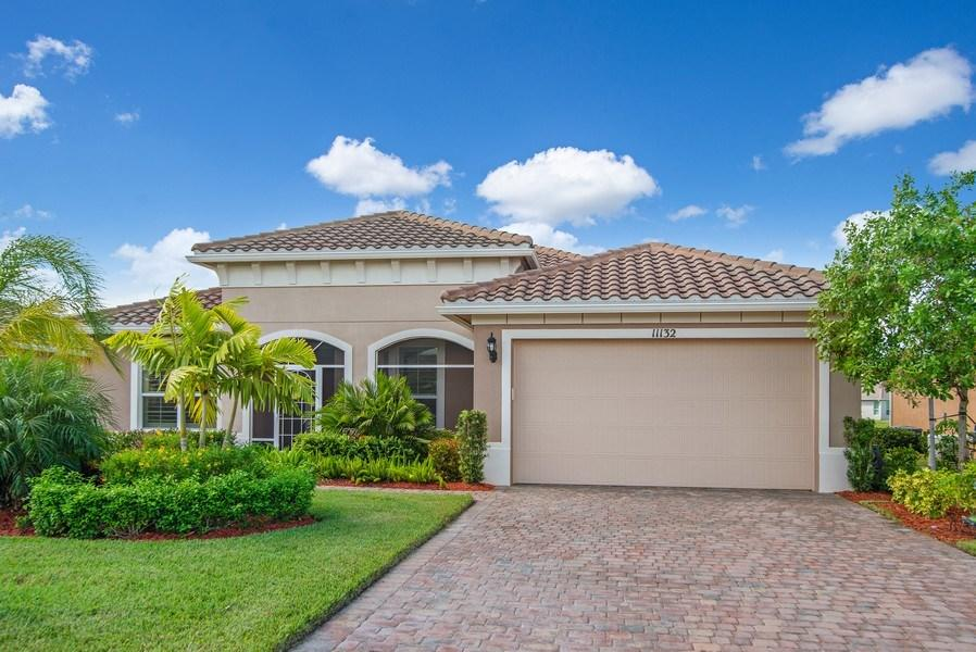 An amazing opportunity to own this impeccable Key Largo model home in one of the best locations in Vitalia! This stunning home boasts 3 bedrooms, +den, 3 full baths, tile throughout main living areas, Plantation Shutters and Hurricane Impact glass. Gourmet Kitchen includes Stainless Steel appliances, double ovens, beautiful 42'' cabinets with crown molding and under cabinet lighting, granite counter tops with glass-tile back splash, walk-in pantry and 12' island. This home features 2 master suites, both with his/her sinks, full tile showers and large walk-in closets. Oversized family room has Surround Sound system and adjoining dining area. 12' triple sliders highlight the screened-in lanai with a relaxing lake front view. Enjoy beautiful Sunsets from your Lanai!!!!! Vitalia at Tradition is an award-winning 55+ community with world-class amenities! Minutes from Tradition Square, I-95 and Saint Lucie West.