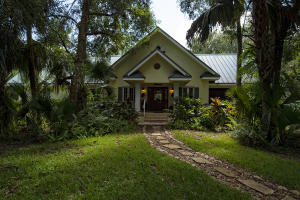 Front of home hidden away in the lush trees