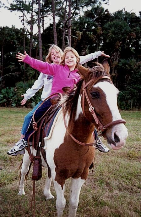 Lindsay & Ali on Snickers - xmas 2000