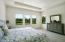 Spacious Master Bedroom Offers Private Access to Pool Area