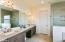 Large Master Bath Offers Private Commode Area and Linen Closet