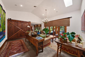5-bedroom residence with 12 and 18 ft height ceilings, nestled on 4.45 acres