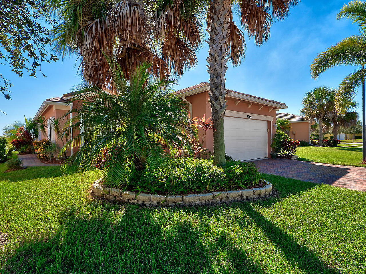 Paradise found with this 3 bedroom and 2 bath home located in Heritage Oaks at Tradition! This beautiful Georgian model features ceramic tile flooring throughout the main living areas, a large spacious great room, and a large kitchen area. The kitchen features custom wood cabinets and a breakfast area perfect for convenient dining . The master bedroom features lake view, a tray ceiling, and an ensuite bath complete with separate shower. Accordion storm shutters. The covered and screened patio are features an outlook that is nothing short of divine. Relax and enjoy the Florida lifestyle while taking in the stunning lakefront vista. Heritage Oaks is a premier community and is close to Tradition Square, which features great shopping, dining, and  easy access to I-95. Schedule a showing today