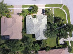Arial view of home and extra large corner lot
