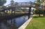 BRIDGE TO A 2ND POOL AREA