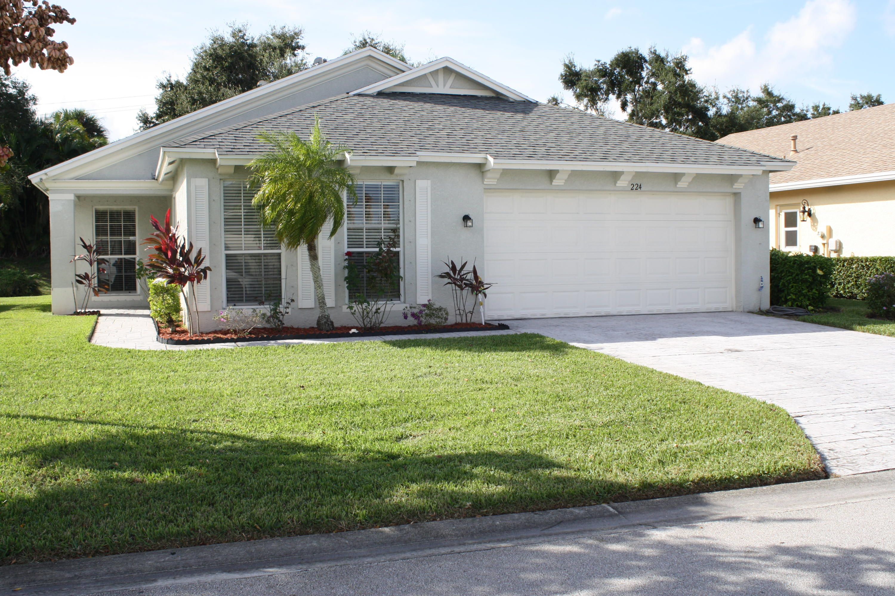 Desirable Lake Forest gated community, CBS 3 bedroom, 2 bath, 2 car garage with a large backyard, AC replaced in 2014, gas water heater in 2015, new toilet in Master bathroom in 2018, concrete stamped and painted driveway in 2014, new screened patio in 2018, exterior of house painted in 2014, wood laminate floors in 2015 and garbage disposal replaced in 2017.  This beautiful community is located in St. Lucie West and just minutes to shopping, schools, & churches.