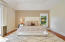 Master Bedroom Suite with hardwood floors and office