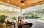Custom designed back porch with Cypress ceiling and travertine tile
