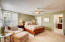 Spacious Master Suite with plantation shutters