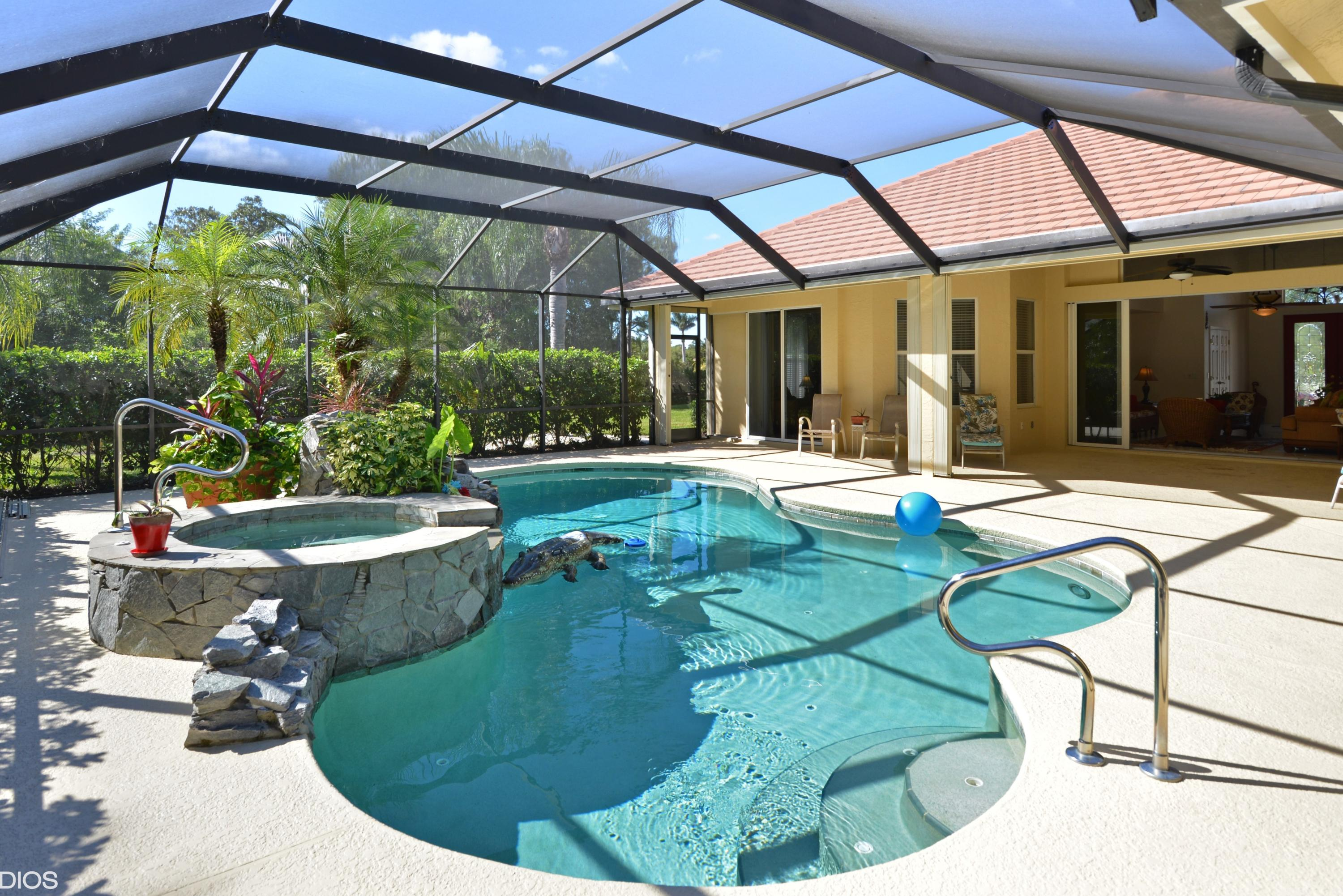 Pool Spa Executive home in PGA Village on lush estate lot. Solidly built 3/3/3 CBS, heated pool/spa,custom open floor plan designed to enjoy the tropical covered screened patio area, pocket sliding doors, newly installed granite kitchen countertops with subway tile backsplash, cabana bath, circular drive and much more. New flat tile roof 2017, exterior painted, home is well maintained and maintenance free. HOA includes the Island Club at PGA Village with  pool, exercise room, tennis, basketball, picnic area and social activities. PGA Village has 3 Champion Golf courses open to the public and several different memberships are available plus the private Legacy Golf Course.(Golf membership is not mandatory.)  Only minutes from St Lucie West where you can find many restaurants, shopping, movies, bowling, medical facilities. Home of the NY Mets Spring Training. The Treasure Coast has amazing waterways for boating, fishing & beaches and located only 45 minutes to PBI.