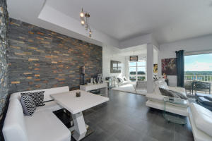 You will love the bright glow of sunshine with your modern open condo from the time you enter.