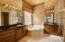 11' Ceiling, Designer Lighting & Beautiful Wood Cabinets