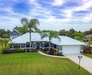 3/2/2 Pool Home plus Xtra 2-story Bldg. behind it. .66 Acres