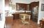 Stainless appliances. Kitchen opens to great/family room