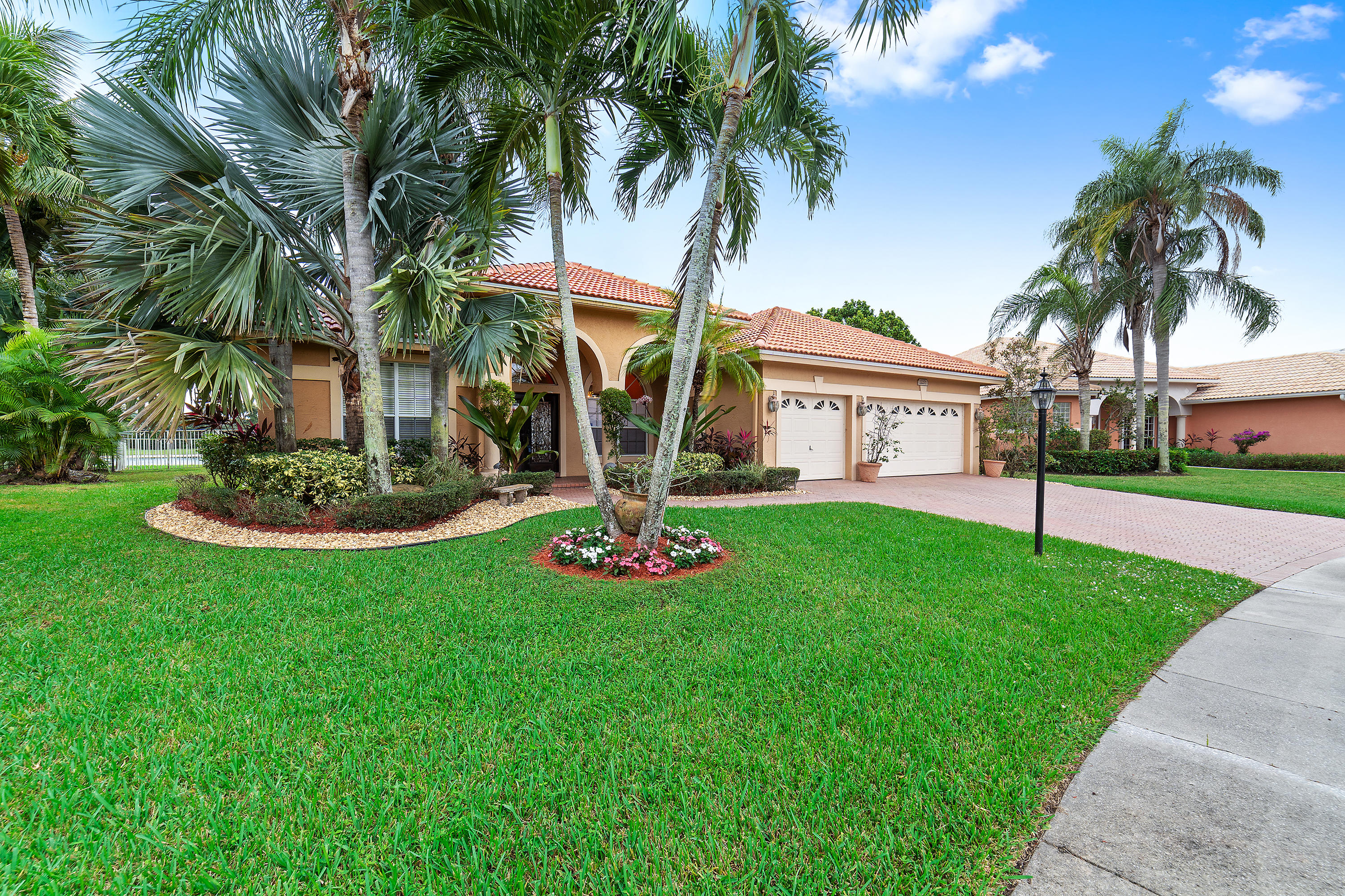This beautiful 5 bed, 3 bath home with breathtaking lake views is on an oversized lot in the sought after community of Boca Falls. This well-cared for home has a split floor plan, playroom, updated kitchen with SS appliances, remodeled master and guest baths, tile & wood flooring, & plenty of natural light. On the exterior this perfectly positioned home has: a New Roof, a fully fenced backyard, with ample space for a pool, 3 car garage, covered patio, hurricane shutters & lush tropical landscaping.  Great home for entertaining & relaxing. Conveniently located close to restaurants, A-Rated schools, shopping, parks & roadways. Boca Falls is a guard gated community with resort style amenities-clubhouse; fitness center; pool; tennis; b-ball; playground. HOA inclds cable & high speed internet.
