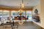 VIEWS FROM KITCHEN INTO DINING AREA WITH INTRACOASTAL IN BACKGROUND