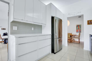 The kitchen features contemporary finishes with Stainless Steel appliances and built-in breakfast bar.