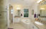 Separate bath and separate shower. Shower has frameless enclosure. Granite counters