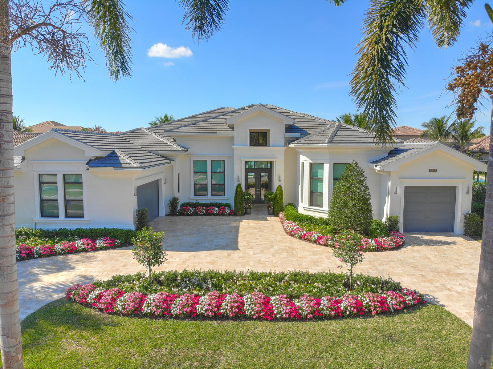 Located in the highly sought after gated community of Seven Bridges, this magnificent house offers 4 bedrooms + office + club room and 5 1/2 bathrooms. Arrive at the circular travertine driveway with vibrant flowers and lush landscaping. Enter into the foyer with high ceilings, leading you into the spacious formal living room. Floor to ceiling windows invite in an abundance of natural light, highlighting the onyx accent wall and built-in fireplace. Family room is open to the dining room, which features tray ceilings and plenty of seating for guests. The well-equipped kitchen includes top of the line stainless steel appliances, walk-in pantry, and custom cabinetry. Flowing seamlessly into the living room, the family room boasts an incredible view of the backyard, gorgeous wall covering, and easy access to patio. The office features custom-built contemporary shelving. Stunning master suite includes sitting area with fabulous lake views, custom California closets, and a spa-like bathroom with double sinks, frameless shower, and freestanding tub. Extra guest rooms all offer en-suite bathrooms. The stunning patio area is complete with a summer kitchen, heated pool, and covered/uncovered seating area. Additional features include a full house generator, motorized window treatments, and impact windows. Hurry in today for your private showing of this spectacular Belvedere model with long lake view!