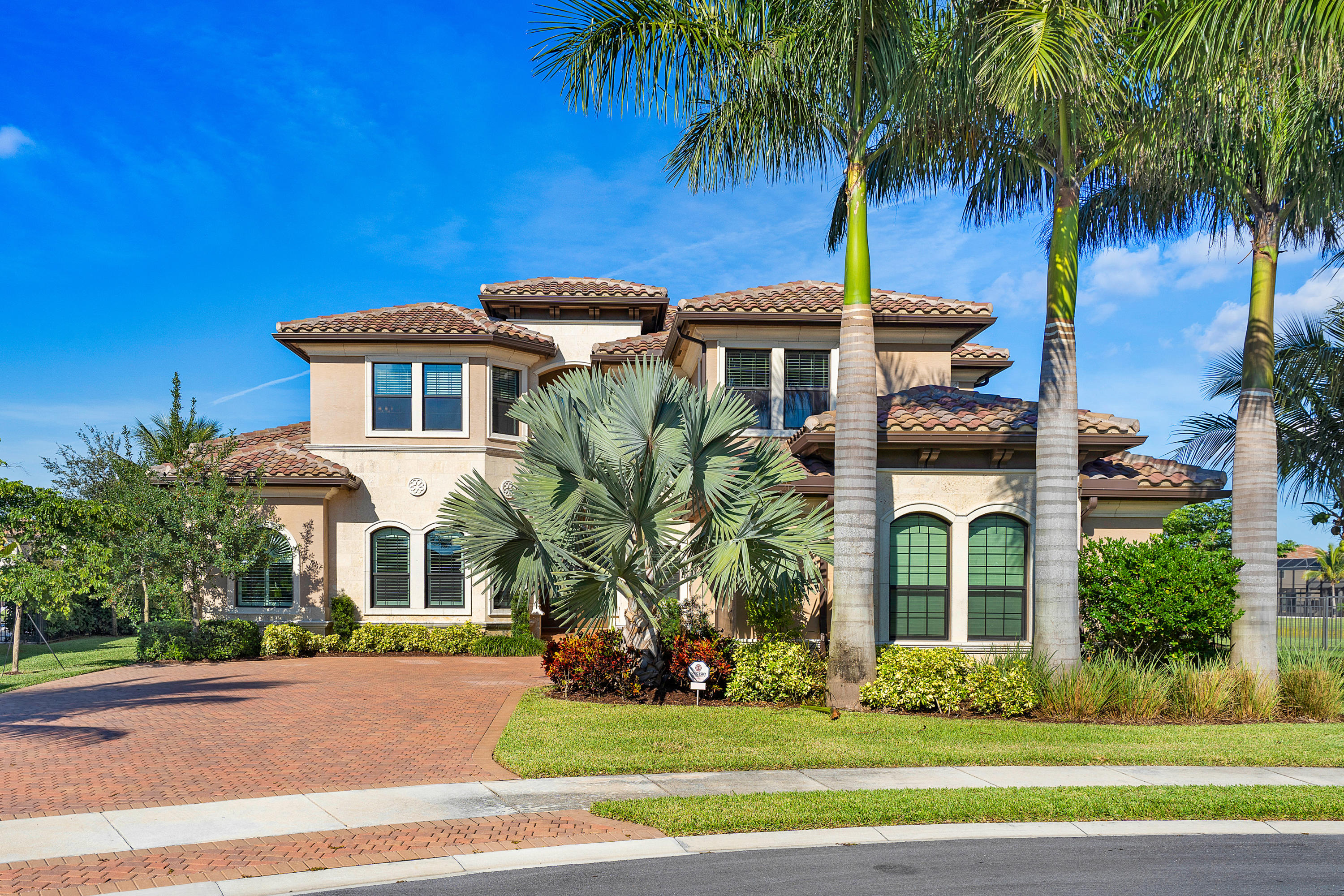 EXCEPTIONAL 2015 BUILT COLONNADE MODEL SITED ON A GORGEOUS, HUGE, PIE-SHAPED, LAKEFRONT LOT IN DELRAYS HOT NEW COMMUNITY, SEVEN BRIDGES!  THIS HOME IS FILLED WITH NATURAL LIGHT AND OFFERS GREAT LAKE VIEWS!  DOUBLE DOOR ENTRY OPENS TO THE FORMAL LIVING ROOM W/ WALL OF GLASS LOOKING OUT OVER THE MARBLE PAVERED POOL DECK TO THE LAKE BEYOND.  THE BEAUTIFULLY FINISHED ISLAND KITCHEN W/ SUB ZERO REFRIGERATOR, WOLF GAS RANGE, BOSCH DISHWASHER AND BUILT IN WOLF COFFEE MAKER, OPENS TO THE LARGE FAMILY ROOM W/ VOLUME CEILINGS AND SHARES THESE MAGNIFICNET VIEWS.  THE SUMPTUOUS FIRST FLOOR MASTER SUITE W/ WOOD FLOORING FEATURES WATER VIEWS, HIS AND HER CLOSETS AND A LARGE BEAUTIFULLY FINISHED MASTER BATH WITH JACCUZI TUB.  AN OFFICE/LIBRARY, FORMAL DINING ROOM, GUEST SUITE, FULL CABANA BATH, LAUNDRY AND POWDER ROOM COMPLETE THE FIRST FLOOR.  A BEAUTIFUL WOOD STAIRCASE LEADS TO A LARGE OPEN LOFT WITH LAKE VIEWS AND 3 ADDITIONAL BEDROOMS EACH WITH FULL BATHS.  EXCEPTIONAL HOME ON AN AMAZING LOT.
