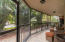 Screen-Enclosed Patio, facing east - lush, tropical landscaping provides total privacy.