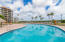 Resort-inspired swimming pool - Porta Bella East has it best! Tiki Bar, bathrooms and shower, and no shortage of lounge chairs, patio table seating & umbrellas for your use.