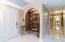 Condo Entryway, Open-Arch Wine Closet & Hallway to Bedrooms & Baths. Chic entry lighting fixture matches both bathrooms!