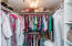 Master Walk-in Closet with new, custom shelving and elegant chandelier (incl.) matches dining room!